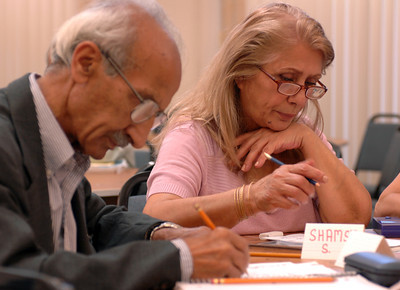 (l-r) Vartan Oroukhanian and Shamsi Mhmoud study during English class.The Armenian Relief Society is celebrating its centennial this year. Glendale, CA 9/16/2010 (John McCoy/staff photographer)