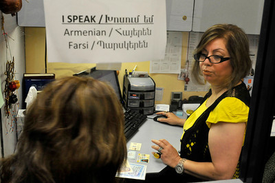 On her cubicle window, Roobina Navasanian has a sign telling clients the languages that she can speak. The Armenian Relief Society is celebrating its centennial this year. Glendale, CA 9/16/2010 (John McCoy/staff photographer)