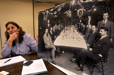 Nyree Derderian holds a photograph from 1910 of the ARS. The Armenian Relief Society is celebrating its centennial this year. Glendale, CA 9/16/2010 (John McCoy/staff photographer)