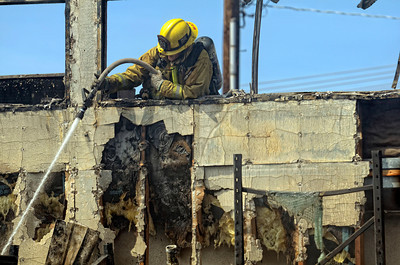 Los Angeles City Firefighters fight a fire that gutted an Arrowhead Water distribution building 9400 block of Mason Ave, in Chatsworth Tuesday, April 3, 2012. It took 116 firefighters 29 minutes to knock down the blaze. (Hans Gutknecht/Staff Photographer)