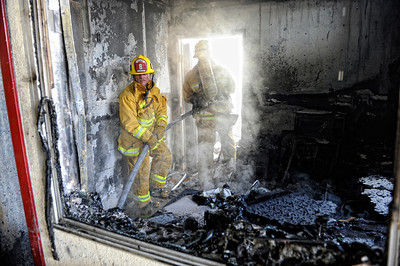 Los Angeles City Firefighter Gage Oetgen, right, and Dan Miller put some water on a fire that gutted an Arrowhead Water distribution building 9400 block of Mason Ave, in Chatsworth Tuesday, April 3, 2012. It took 116 firefighters 29 minutes to knock down the blaze. (Hans Gutknecht/Staff Photographer)