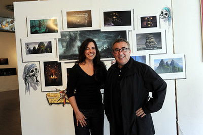 """Gallery coordinator Nicki La Rosa and conceptual artist Mauro Borrelli with some of Borrelli's work at Gallery 800 in North Hollywood, CA Friday, January 14, 2011. An Opening Reception will take place January 16 at the gallery for """"As Seen at Comic-Con: an Exhibition of Professional WorkÊ by the Illustrators of the ADG"""" (Hans Gutknecht/Staff Photographer)"""