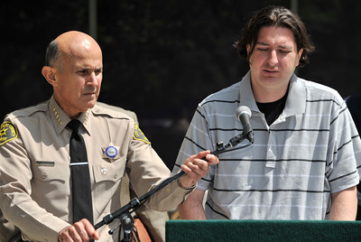 Sheiff Leroy Baca adjusts the microphone so that Robert Klein can make a statement. On June 15, 2011 Renata Klein was discovered deceased on upper Big Tujunga Canyon Road. The victim's husban, Dusan Klein, a 6-year-old Cocker Spanile and Jedep Cherokee are currently missing. Robert Klein, the son, appeared at a press conference at the Los Angeles County Sheriff's Department to ask for help in locating his father. Monterey Park, CA 6-23-2011. (John McCoy/Staff Photographer)