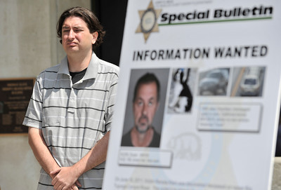 Robert Klein stands next to a wanted poster with his fathers photo on it. On June 15, 2011 Renata Klein was discovered deceased on upper Big Tujunga Canyon Road. The victim's husban, Dusan Klein, a 6-year-old Cocker Spanile and Jedep Cherokee are currently missing. Robert Klein, the son, appeared at a press conference at the Los Angeles County Sheriff's Department to ask for help in locating his father. Monterey Park, CA 6-23-2011. (John McCoy/Staff Photographer)
