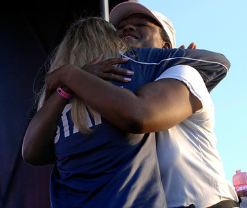 70916- Stephen Carr/Press-Telegram Bellflower resident and three time cancer survivor Shonte Hendersongets a hug from Avon Walk Los Angeles operations manager Sarah Zurbuchen,left,  during the opening ceremony for the Avon Walk For Breast Cancer, held at  the Queen Mary Events Park. The event helps raise money to advance access to care and finding a cure for breast cancer, with a focus on the medically undeserved. 1900 women and men participating raising $ 4.3 million.