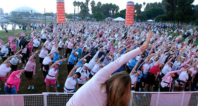 70916- Stephen Carr/Press-Telegram  Shannon VonBurns, of Exhale Spa in Venice leads participants in a stretching yoga class before the start the Avon Walk For Breast Cancer  at Queen May Events Park. The event helps raise money to advance access to care and finding a cure for breast cancer, with a focus on the medically undeserved. 1900 women and men participating raising $ 4.3 million.
