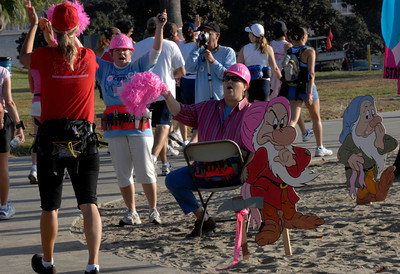 70916- Stephen Carr/Press-Telegram Volunteers Cindy Kruse,left, of Chino Hills, and Marian Soderholm,right, of Long Beach, cheer on participants during the Avon Walk For Breast Cancer, in Long Beach. The event helps raise money to advance access to care and finding a cure for breast cancer, with a focus on the medically undeserved. 1900 women and men participating raising $ 4.3 million.