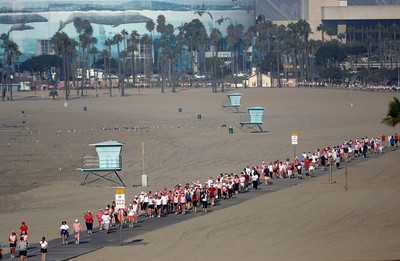 70916- Stephen Carr/Press-Telegram  Participants walk along the Long Beach pedestrian path along the beach, during the Avon Walk For Breast Cancer, in Long Beach. The event helps raise money to advance access to care and finding a cure for breast cancer, with a focus on the medically undeserved. 1900 women and men participating raising $ 4.3 million.