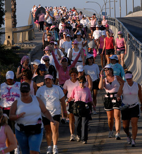 70916- Stephen Carr/Press-Telegram  Participants cross the Queensway Bridge, during the Avon Walk For Breast Cancer,in Long Beach. The event helps raise money to advance access to care and finding a cure for breast cancer, with a focus on the medically undeserved. 1900 women and men participating raising $ 4.3 million.