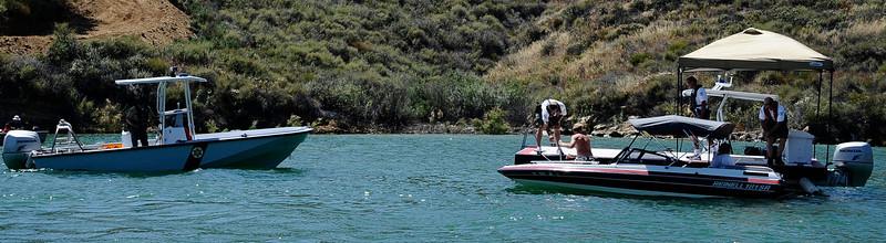 (L) LA county Sheriff's Sgt. Roger Wallace checks out boaters on Castaic Lake during Operation Dry Water by conducting traffic stops and B.U.I. sobriety check points.  Castaic Lake CA. June 26,2011. Photo by Gene Blevins/LA Daily News