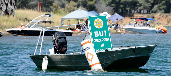 The SheriffÕs Department will have signs on display to increase its presence at both Castaic Lake and Pyramid Lake during Operation Dry Water by conducting traffic stops and B.U.I. sobriety check points.  Castaic Lake CA. June 26,2011. Photo by Gene Blevins/LA Daily News  Sheriff's Sgt. Roger Wallace