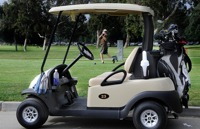 A cart and golfer are ready to go on the first tee at the Encino course. The City of Los Angeles just purchased new golf carts for several courses including the Encino Balboa Golf Complex. Encino, CA 6-24-2011. (John McCoy/Staff Photographer)
