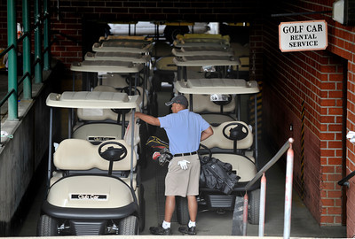 Ken Sugay gets ready to put his clubs on a new golf cart. The City of Los Angeles just purchased new golf carts for several courses including the Encino Balboa Golf Complex. Encino, CA 6-24-2011. (John McCoy/Staff Photographer)