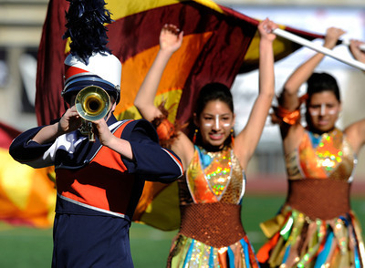 The Chatsworth High School Marching Band was accentuated by the drill team that wore African inspired costumes. The annual LAUSD Band and Drill Team Championship competition was held at East Los Angeles College. The competition featured an estimated 2,500 high school students representing 30 schools. The groups were evaluated on their visual ad musical performance. Monterey Park CA 12/10/2011(John McCoy/Staff Photographer)
