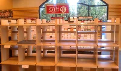 Lots of empty book shelfs are left at the Barnes & Noble bookstore next to  Starbucks a popular hangout spots at Ventura and Hayvenhurst in Encino. The bookstore closes for good at 6 p.m., forced out by higher rents and is being replaced by a CVS store. Encino CA Dec 31,2010. Photo by Gene Blevins/LA DailyNews