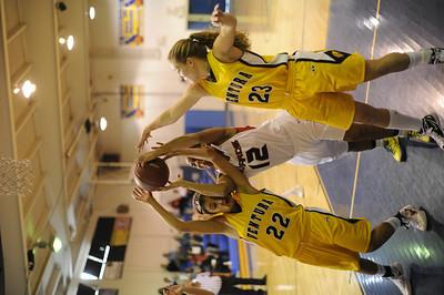 Bell-Jeff's Jasmine Smith (12) battles for a rebound with Ventura's  Kayalin Aikens-Irby (22) and Sam Meyer (23) during their girls' basketball game at St. Bernard High School in Playa del Rey Saturday, January 14, 2012. (Hans Gutknecht/Staff Photographer)