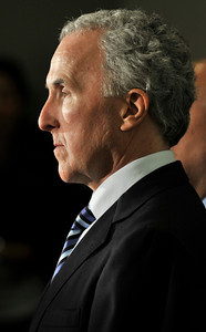 Los Angeles Dodgers owner Frank McCourt listens during a press conference at the Police Administration Building in Los Angeles, CA 4-8-2011. (John McCoy/staff photographer)