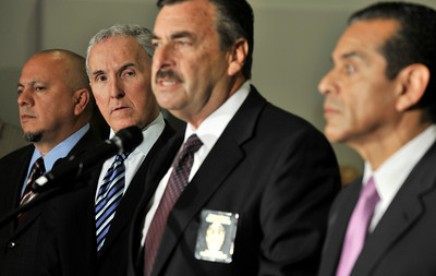 (l-r) City Councilman Ed Reyes, Los Angeles Dodgers owner Frank McCourt,  Los Angeles Police Department Chief Charlie Beck and Mayor Antonio Villaraigosa held a press conference at the Police Administration Building in Los Angeles where they talked about new security measures that will be implemented at Dodger Stadium.  CA 4-8-2011. (John McCoy/staff photographer)