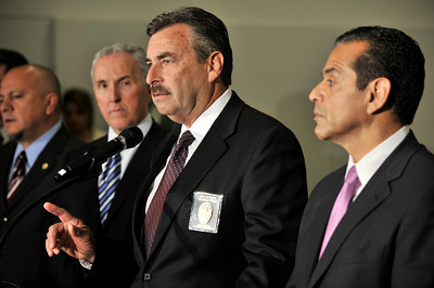 (l-r) L.A. City Councilman Ed Reyes and Los Angeles Dodgers owner Frank McCourt Mayor listen to Los Angeles Police Department Chief Charlie Beck, while Mayor Antonio Villaraigosa stands by. The city leaders held a press conference at the Police Administration Building in Los Angeles, CA 4-8-2011. (John McCoy/staff photographer)