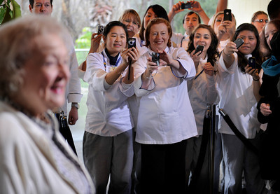 Chefs and students take a photo of Betty White. The Greater Los Angeles Zoo Association (GLAZA) fetes its Chairman Betty White on the occasion of her 90th Birthday at a private event for LA Zoo Keepers and GLAZA Trustees with a life-size birthday cake created by the presigious Le Cordon Bleu College of Culinary Arts in Hollywood.  Standing 5' tall, the chocolate blackout cake with valrhona ganache, lamill coffee and valrhona crunchy pearls contains 90 lbs. sugar, 50 lbs. flour, 50 lbs. butter, 470 eggs and 100 cups of coffee, among other ingredients.  Los Angeles CA 1/21/2012(John McCoy/Staff Photographer)