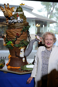 The Greater Los Angeles Zoo Association (GLAZA) fetes its Chairman BETTY WHITE on the occasion of her 90th Birthday at a private event for LA Zoo Keepers and GLAZA Trustees with a life-size birthday cake created by the presigious Le Cordon Bleu College of Culinary Arts in Hollywood.  Standing 5' tall, the chocolate blackout cake with valrhona ganache, lamill coffee and valrhona crunchy pearls contains 90 lbs. sugar, 50 lbs. flour, 50 lbs. butter, 470 eggs and 100 cups of coffee, among other ingredients.  Los Angeles CA 1/21/2012(John McCoy/Staff Photographer)