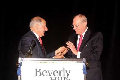 Ronald M. George receives the award from Justice Kennedy.  The Beverly Hills Bar Association (BHBA), expanding on its tradition of championing access to justice, an independent judiciary and the Rule of Law, honored two titans of the legal community at its inaugural ÒBeverly Hills Bar Association Litigation Section Dinner,Ó on Wednesday, February 2, 2011, at Montage Beverly Hills. More than 300 legal glitterati turned out to salute recently-retired California Supreme Court Chief Justice Ronald M. George, considered one of the most effective judicial administrators in the stateÕs history, and renowned trial lawyer Roman M. Silberfeld, widely respected for his groundbreaking work on a range of complex litigation cases, including the recent entertainment case Celador International Ltd. v. The Walt Disney Company, for which he obtained a verdict for a record amount of $319 million.  Lee Salem Photography    Chief Justice George, a long-time Beverly Hills resident, was presented with the BHBAÕs inaugural ÒAward for Judicial ExcellenceÓ by U.S. Supreme Court Justice Anthony Kennedy and Justice GeorgeÕs son, attorney Eric George, of the law firm Browne Woods George LLP.  The award will be named after the newly-retired ÒhometownÓ justice and presented annually to a standout member of the judiciary.  It is one of only a handful of awards he has allowed to be named for him.