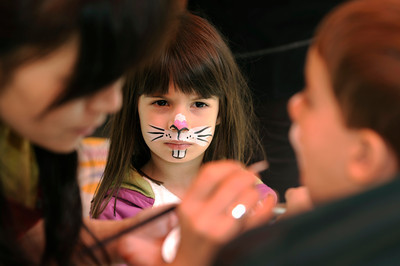 Desha Silberstein,4, keeps an eye on her little brother Cole,2, while he gets his face painted. The Los Angeles Zoo's annual three-day event, Big Bunny's Spring Fling, features bunny related crafts and activities including the Be-A-Bunny Ear Craft and Funny Bunny Face Painting. Children can also pet fuzzy wuzzy bunnies and plant their own carrot seeds to take home. In addition (for a nominal fee), Big Bunny will be available for souvenir photos. Los Angeles, CA 4-22-2011. (John McCoy/staff photographer)
