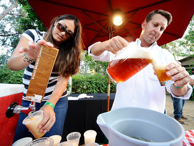 (L) Jenni Ito helps her husband Rich Marcello from the Strand Brewing Co. to keep the beer flowing during the annual  Brew at the Zoo, as over 2000 beer lovers came out to sample 20 different kinds of brews makers beers at the LA zoo. Los Angeles. CA. Aug 12,2011 photo by Gene Blevins/LA DAILY NEWS