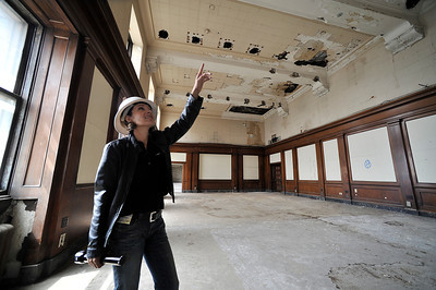 Alicia Ramos points to the ceiling above one of the courtrooms that will become a conference room for the Sheriff. Above this floor was the jail, where Ramos said prisoners would clog of the toilets so that water would flood into the courtrooms below. The county will begin work on a $231 million renovation to the Hall of Justice, which has been vacant since the 1994 Northridge Earthquake. The historic Beaux Arts building was built in 1925. Los Angeles, CA. 8-10-2011. (John McCoy/Staff Photographer)