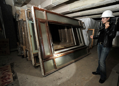 Alicia Ramos looks at metal door frames that were painted to look like wood. The county will begin work on a $231 million renovation to the Hall of Justice, which has been vacant since the 1994 Northridge Earthquake. The historic Beaux Arts building was built in 1925. Los Angeles, CA. 8-10-2011. (John McCoy/Staff Photographer)