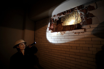 Alicia Ramos points out where part of the wall was removed to see what was behind the tile. The county will begin work on a $231 million renovation to the Hall of Justice, which has been vacant since the 1994 Northridge Earthquake. The historic Beaux Arts building was built in 1925. Los Angeles, CA. 8-10-2011. (John McCoy/Staff Photographer)