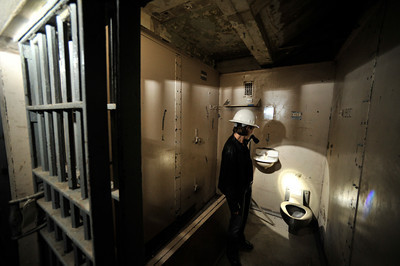 Alicia Ramos looks around inside of one of the jail cells that had been torn our of the 10th floor and relocated to the first floor for a display. The county will begin work on a $231 million renovation to the Hall of Justice, which has been vacant since the 1994 Northridge Earthquake. The historic Beaux Arts building was built in 1925. Los Angeles, CA. 8-10-2011. (John McCoy/Staff Photographer)