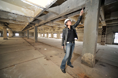 Alicia Ramos points out where the ceiling will be reomoved on the 10th floor, in the area above where the jail used to be. The county will begin work on a $231 million renovation to the Hall of Justice, which has been vacant since the 1994 Northridge Earthquake. The historic Beaux Arts building was built in 1925. Los Angeles, CA. 8-10-2011. (John McCoy/Staff Photographer)