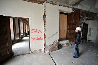 Alicia Ramos stands outside the door to the judges chambers next to the courtroom. The county will begin work on a $231 million renovation to the Hall of Justice, which has been vacant since the 1994 Northridge Earthquake. The historic Beaux Arts building was built in 1925. Los Angeles, CA. 8-10-2011. (John McCoy/Staff Photographer)