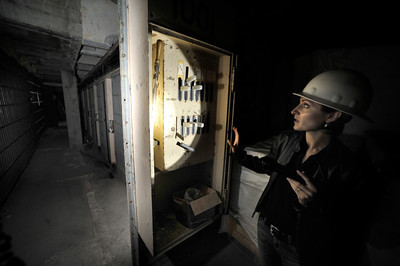 Alicia Ramos looks at levers that were used to open the jail cells that had been torn our of the 10th floor and relocated to the first floor for a display. The county will begin work on a $231 million renovation to the Hall of Justice, which has been vacant since the 1994 Northridge Earthquake. The historic Beaux Arts building was built in 1925. Los Angeles, CA. 8-10-2011. (John McCoy/Staff Photographer)