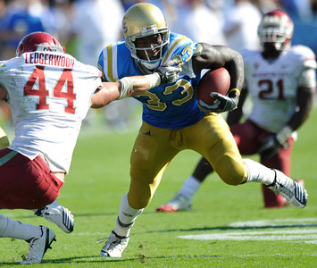 Bruin #33 Derick Coleman gets around Mike Ledgerwood. UCLA took on the Washington State Cougars in a game at the Rose Bowl in Pasadena, CA. 10/2/10 (John McCoy/staff photographer)