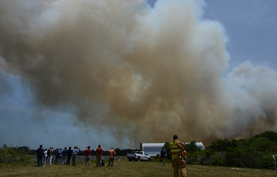 A 60 plus acre brush fire burns out of control near the Kennedy Space Center media center. The fire started  around 12 noon as winds 10-15 mph push it through the marchlands three miles from the space shuttle Endeavour. Kennedy Space Center FL, April 27,2011 Photo by Gene Blevins/LA Daily News