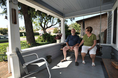 The Burtons sit on the front porch swing at their 100 year old house. The City of Burbank granted a historical designation to the two story farm house owned by Kent and Marlene Burton on E. Magnolia Blvd. Burbank, CA 6-22-2011. (John McCoy/Staff Photographer)