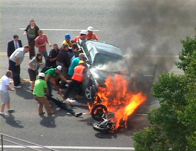 APTOPIX Burning Car Heroes