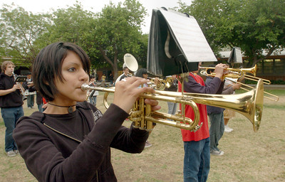 Cleveland High School band member, Olga Sanchez, 17, plays during the rally against the proposed MTA fare hike on Monday, May 21, 2007 in Reseda, Ca. (Tina Burch/Staff Photographer)
