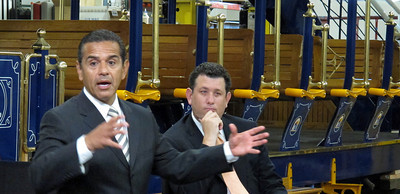 Mayor Antonio Villaraigosa and Deputy Mayor Matt Karatz during the roundtable.  Behind them is a self-powered hybrid heritage-style trolley that can carry 75 passengers.The TIG/m plant in Chatsworth, provided the backdrop for the Mayor's roundtable with business leaders from across the City of Los Angeles, meeting to discuss their efforts to create jobs and lift the local economy out of recession.  TIG/m manufactures fully self-powered, sustainable-design streetcars, contributing to LA's role as a leading global clean technology hub and helping to grow the City's export economy by building projects around the world, including a 2,000 acre residential and recreational trolley system in Baja California and is currently working on a trolley system in a mixed-use development in San Antonio,TX.  They are also in the running to build a green trolley service in Doha, Qatar, and currently contracted for a system in Dubai, UAE. Their sustainable streetcars systems have been used to improve circulation and public transit use, revitalize urban cores, promote mixed-use development, and bring green transportation options to residential neighborhoods.  The Mayor's Office and the Minority Business Development Agency Business Center - Los Angeles (MBC-LA) have worked with TIG/m to help them identify financing and procure contracts around the country and internationally.  (Dean Musgrove/Staff Photographer)
