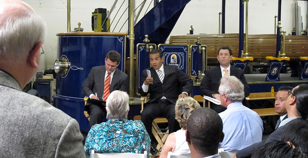Daymond Rice, Chair, VICA, Mayor Antonio Villaraigosa and Deputy Mayor Matt Karatz during the roundtable.  Behind them is a self-powered hybrid heritage-style trolley that can carry 75 passengers.The TIG/m plant in Chatsworth, provided the backdrop for the Mayor's roundtable with business leaders from across the City of Los Angeles, meeting to discuss their efforts to create jobs and lift the local economy out of recession.  TIG/m manufactures fully self-powered, sustainable-design streetcars, contributing to LA's role as a leading global clean technology hub and helping to grow the City's export economy by building projects around the world, including a 2,000 acre residential and recreational trolley system in Baja California and is currently working on a trolley system in a mixed-use development in San Antonio,TX.  They are also in the running to build a green trolley service in Doha, Qatar, and currently contracted for a system in Dubai, UAE. Their sustainable streetcars systems have been used to improve circulation and public transit use, revitalize urban cores, promote mixed-use development, and bring green transportation options to residential neighborhoods.  The Mayor's Office and the Minority Business Development Agency Business Center - Los Angeles (MBC-LA) have worked with TIG/m to help them identify financing and procure contracts around the country and internationally.  (Dean Musgrove/Staff Photographer)