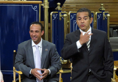Councilmember Mitch Englander and Mayor Antonio Villaraigosa during the roundtable.  Behind them is a self-powered hybrid heritage-style trolley that can carry 75 passengers.The TIG/m plant in Chatsworth, provided the backdrop for the Mayor's roundtable with business leaders from across the City of Los Angeles, meeting to discuss their efforts to create jobs and lift the local economy out of recession.  TIG/m manufactures fully self-powered, sustainable-design streetcars, contributing to LA's role as a leading global clean technology hub and helping to grow the City's export economy by building projects around the world, including a 2,000 acre residential and recreational trolley system in Baja California and is currently working on a trolley system in a mixed-use development in San Antonio,TX.  They are also in the running to build a green trolley service in Doha, Qatar, and currently contracted for a system in Dubai, UAE. Their sustainable streetcars systems have been used to improve circulation and public transit use, revitalize urban cores, promote mixed-use development, and bring green transportation options to residential neighborhoods.  The Mayor's Office and the Minority Business Development Agency Business Center - Los Angeles (MBC-LA) have worked with TIG/m to help them identify financing and procure contracts around the country and internationally.  (Dean Musgrove/Staff Photographer)