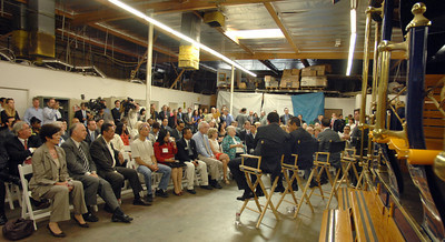 The TIG/m plant in Chatsworth, provided the backdrop for the Mayor's roundtable with business leaders from across the City of Los Angeles, meeting to discuss their efforts to create jobs and lift the local economy out of recession.  TIG/m manufactures fully self-powered, sustainable-design streetcars, contributing to LA's role as a leading global clean technology hub and helping to grow the City's export economy by building projects around the world, including a 2,000 acre residential and recreational trolley system in Baja California and is currently working on a trolley system in a mixed-use development in San Antonio,TX.  They are also in the running to build a green trolley service in Doha, Qatar, and currently contracted for a system in Dubai, UAE. Their sustainable streetcars systems have been used to improve circulation and public transit use, revitalize urban cores, promote mixed-use development, and bring green transportation options to residential neighborhoods.  The Mayor's Office and the Minority Business Development Agency Business Center - Los Angeles (MBC-LA) have worked with TIG/m to help them identify financing and procure contracts around the country and internationally.  (Dean Musgrove/Staff Photographer)
