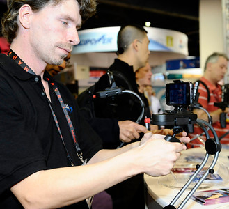 Ruben Sluijter of the Tiffen Company shows the new steady cam for smart phones video shooting, during the 3rd day of the 2011 International CES. Las Vegas NV. Jan 8,2011. Photo by Gene Blevins/LA Daily news