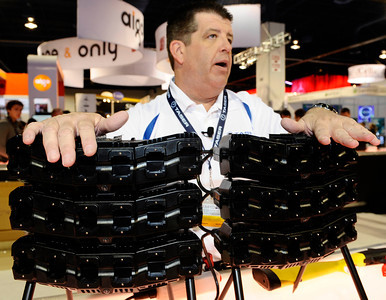 Doug Dirren of Taser International shows the new multi taser discharge unit during the 3rd day of the 2011 International CES. Las Vegas NV. Jan 8,2011. Photo by Gene Blevins/LA Daily news