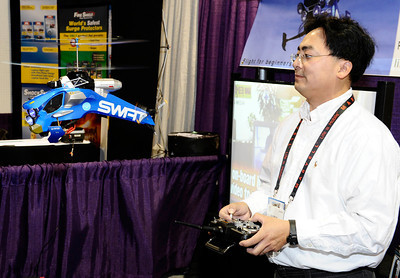 Patrick Le of digitronics Inc shows the SWAT remote control helicopter that has up to a one mile range, on board camera and runs for 15 minutes, during the 3rd day of the 2011 International CES. Las Vegas NV. Jan 8,2011. Photo by Gene Blevins/LA Daily news