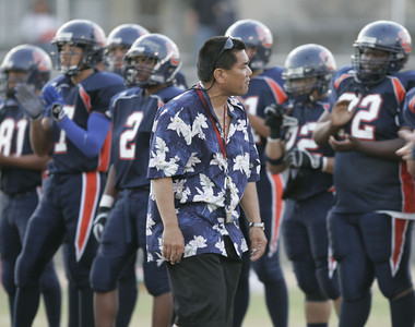 Chatsworth's Head Coach Rick Hayashida talks with his players before the game on Thursday, September 20, 2007 aganist Chaminade High School. (Edna T. Simpson)