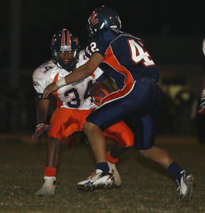 Chaminade's Chris Warren looks to past in front of Chatsworth's Anthony Flores during the first half on Thursday, September 20, 2007 at Chatsworth High School. (Edna T. Simpson)