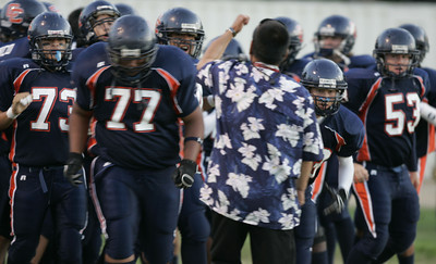 Chatsworth's Head Coach Rick Hayashida pump up his players before the game on Thursday, September 20, 2007 against Chaminade High School. (Edna T. Simpson)